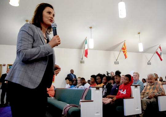 Gov. Gretchen Whitmer addresses residents of Benton Harbor at a special community meeting on June 5  to discuss the state's proposal to close the high school.