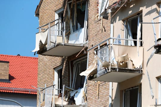 A view of damaged balconies and windows at a block of flats that were hit by an explosion, in Linkoping, Sweden.