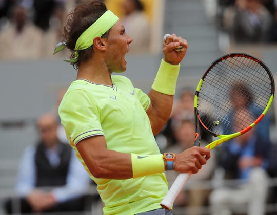 Spain's Rafael Nadal scores a point against Switzerland's Roger Federer during their semifinal match Friday.
