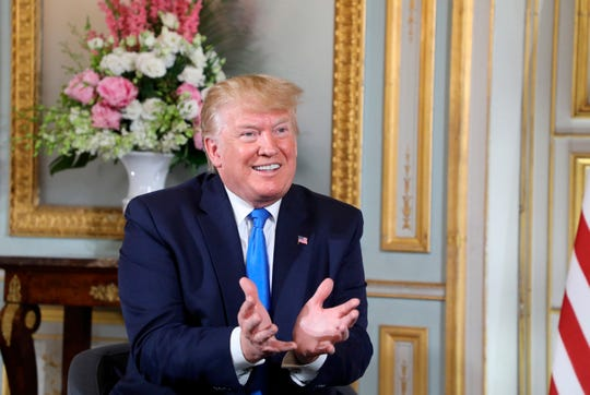 U.S President Donald Trump gestures during a meeting with with French President Emmanuel Macron at the Prefecture of Caen, Normandy, France, Thursday, June 6, 2019.
