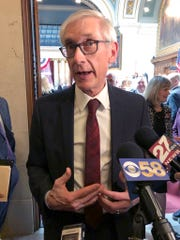 """In this Tuesday, April 9, 2019, file photo, Wisconsin Democratic Gov. Tony Evers talks to reporters in Madison, Wisconsin. Flying a gay pride rainbow flag over the Wisconsin state Capitol for the first time is drawing backlash from a conservative Republican lawmaker who said it was divisive. The flag flap Friday erupted after Evers ordered the raising of the flag to recognize June as """"Pride Month."""" The move drew a fast backlash from state Rep. Scott Allen, who tweeted, """"Is this any more appropriate than erecting the Christian flag over the Capitol?"""" Democrats praised the raising of the flag."""