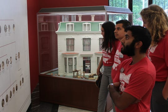 Ohio State University students Amun Mehta, Hannah Woods, Zachary Salinas and Livie Sears take a look at Rutherford and Lucy Hayes' family tree Thursday at the Rutherford B. Hayes Presidential Library and Museums in Fremont. The students traveled with OSU President Michael Drake to Fremont.