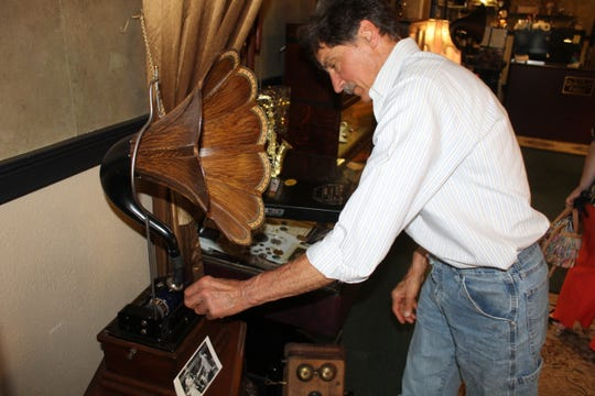 Bernie Overmyer, owner of State Street's Overmyer Jewelers and Clock Repair, turns on an Edison phonograph Wednesday at his store. Overmyer said Downtown Fremont has made improvements in the downtown area and the city needs to continue making State, Croghan and Arch streets attractive for businesses and residents.