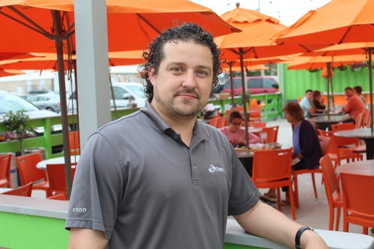 Shawn Kern, co-owner of The Garrison restaurant in downtown Fremont, said his business opened a new beer garden with additional outdoor seating for the popular downtown eatery.