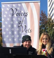 Todd Simon (left) and Kassie Sandacz perform together during a Voices of Vets event.