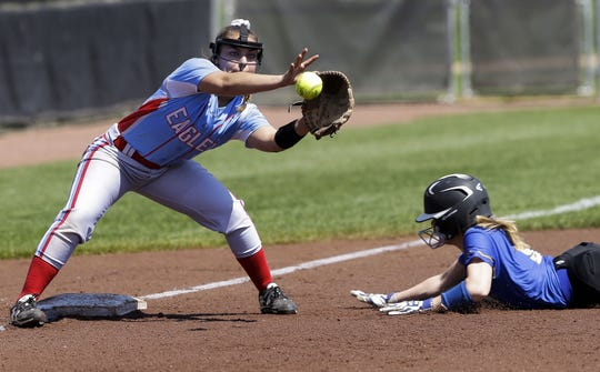 Southern Door's Jackie Atkins (3) catches a throw as Campbellsport's Adriana Dechant (9) slides into third base during a Division 3 state semifinal Friday at Goodman Diamond in Madison.