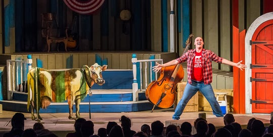 """Alex Campea is joined by Lola the Cow for a musical number in a scene from Northern Sky Theater's 2018 production of """"Dairy Heirs."""" The show returns for the 2019 summer season at Northern Sky."""