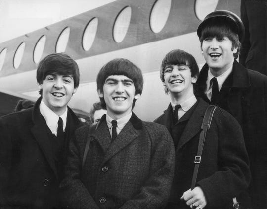 The Beatles, left to right, Paul McCartney, George Harrison, Ringo Starr and John Lennon arrive at London Airport February 6, 1964, after a trip to Paris.