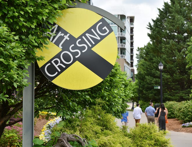 A sign marks the Art Crossing area of the River Walk in downtown Greenville.
