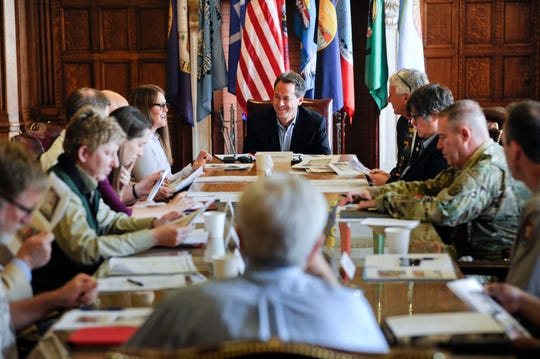 Gov. Steve Bullock meets with local, state and federal officials for a briefing on the upcoming wildfire season Friday at the State Capitol in Helena, Mont.