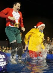 Frank Soltys, left, and Bob Norbie take the Polar Plunge for Montana Special Olympics of Montana during a recent Christmas Stroll.