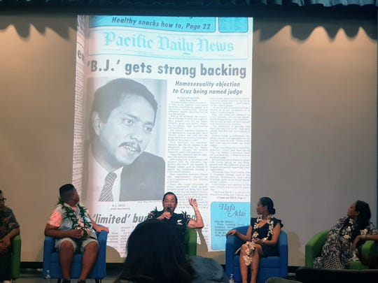 Public Auditor Benjamin Cruz presents a 1984 Pacific Daily News headline during the 2019 Guam Pride Talk on June 6, 2019.  The article was from  when he was up for nomination to serve as a judge for the Superior Court of Guam and faced criticism over being openly gay.