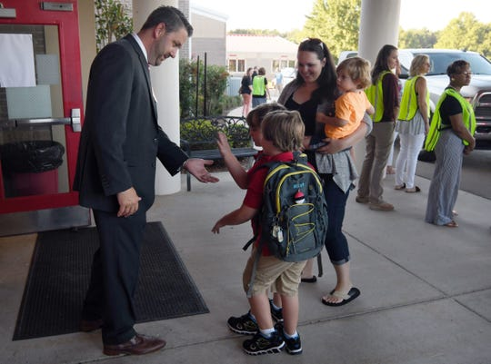 Matt Dillon, Petal School District Superintendent, welcomes students and their parents on the first day of school at Petal Primary on Aug. 7, 2018.
