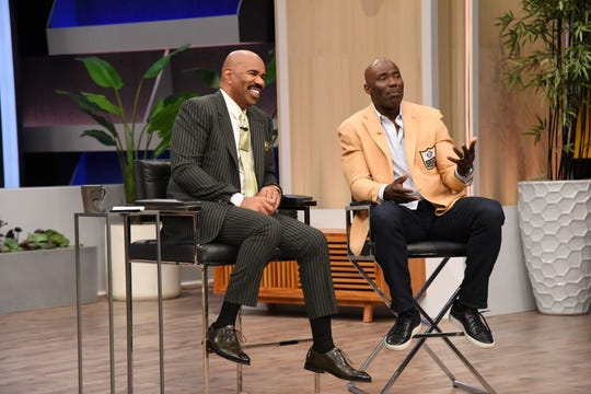 "Steve Harvey, left, and Terrell Davis, on the set of the ""Steve!"" show on Haggar Hall of Fame Dad day, filmed in Los Angeles in mid-May 2019."