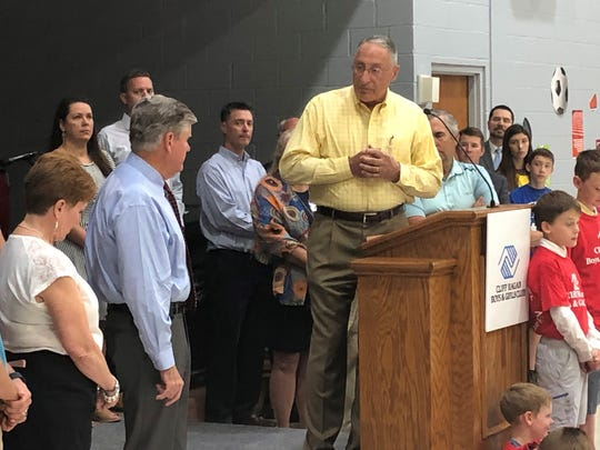 Board member Bill Fidler addresses the gathering at the Boys and Girls Club of Henderson's fundraising kickoff celebration Friday morning at Community Baptist Church.