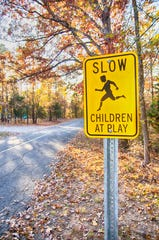 "A ""children at play"" sign."