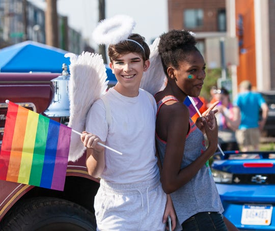 Josh Glore practices waving his flags for the start of the Indy Pride Parade in downtown Indianapolis on Saturday, June 9, 2018. The parade route began at College and Massachusetts avenues and headed west toward Military Park.
