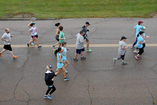 Runners begin the 1-mile run of the Twilight Glow Run, Thursday evening, June 6.