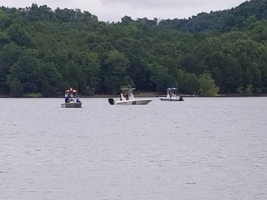 Rescue crews search for a drowning victim at Douglas Lake in Jefferson County on Friday.