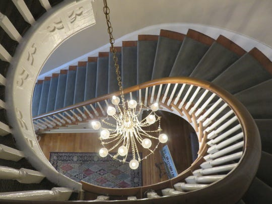 The view down the spiral staircase from an upper floor in the Duncan School of Law building.