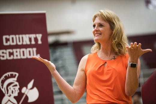 Lady Vols coach Kellie Harper reacts to having her elementary school basketball court named after her, at a celebration in her honor at her former high school in White County High School, in Sparta, Tennessee, Thursday, June 6, 2019.