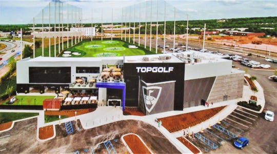 "This depiction of the Top Golf facility in Greenville, South Carolina, is similar to what the proposed Outlet Drive location would look like. ""The contemporary design is integral to the brand image,"" said Director of Real Estate Development Todd Waldo."