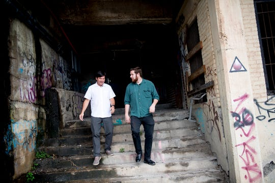 Knox News urban life writer Ryan Wilusz and Mark Heinz of Dewhirst Properties exit the underground level of the 100 Block of Gay Street at Jackson Avenue in Knoxville, Tennessee on Friday, June 7, 2019. The 100 Block of Gay Street was raised by one story 100 years ago to build the railroad viaduct to help accommodate large amounts of pedestrian and vehicle traffic. Many of those buildings now have sub-basements.