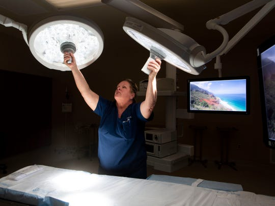 Jodi Webb of STERIS, a medical device company, adjusts the surgical lighting equipment in one of Tennova's North Knoxville Medical Center's new operating rooms on Thursday, June 6, 2019.