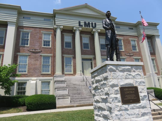 A statue of Abraham Lincoln adorns the front lawn of the historic LMU Duncan School of Law off Summit Hill Avenue.