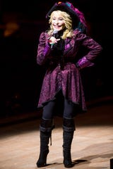 Dressed as a pirate, Dolly Parton speaks to guests prior to the start of her new Pirates Voyage Dinner & Show in Pigeon Forge on Friday, June 7, 2019.