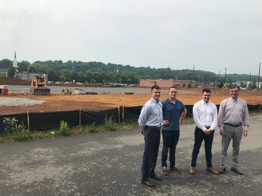 At the site of Tennessee's first Duluth Trading Co. store in Kingston Corner shopping center, (left to right) Will Sims and Chad Turner of Oliver Smith Realty & Development stand with developers Ryan and Rick Chinn of R&R Properties.