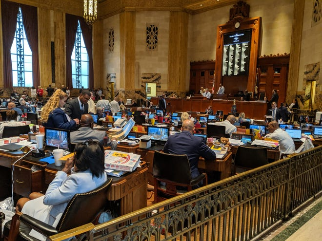 House lawmakers on Thursday passed a $30 billion state budget, including $1,000 and $500 pay raises for teachers and support workers, and a $39 million block grant for public school districts.