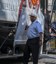 Mastern St. Julien is shown by UL's bus at the Sun Belt Men's Basketball Tournament in New Orleans in March. St. Julien, longtime bus driver for Ragin' Cajuns athletes, died Monday. Services will be held June 14.