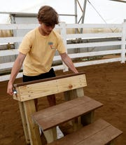 Will Custer takes apart the portable mounting block he built for the Fairfield County Special Olympics Equestrian team Thursday, June 6, 2019, at Home of Joy Farm in Pleasant Township. Custer built two mounting blocks for the team as part of his Eagle Scout project.