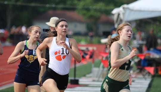 Brighton's Maddie Brown (10) runs just behind Howell's Ashlyn Tait during the 800-meter run at the state Division 1 track and field meet at East Kentwood on Saturday, June 1, 2019. Brown and Tait both broke the former Livingston County record.