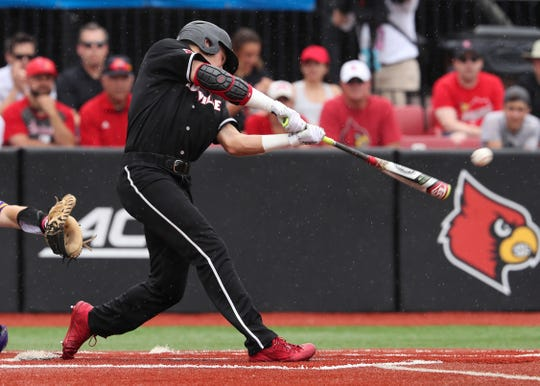 Louisville's Jake Snider (20) singles to right field against East Carolina during the Super Regional at Patterson Stadium in Louisville. June 07, 2019.