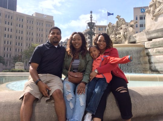 Armon R. Perry, an associate professor at the University of Louisville's Kent School of Social Work, with his family.