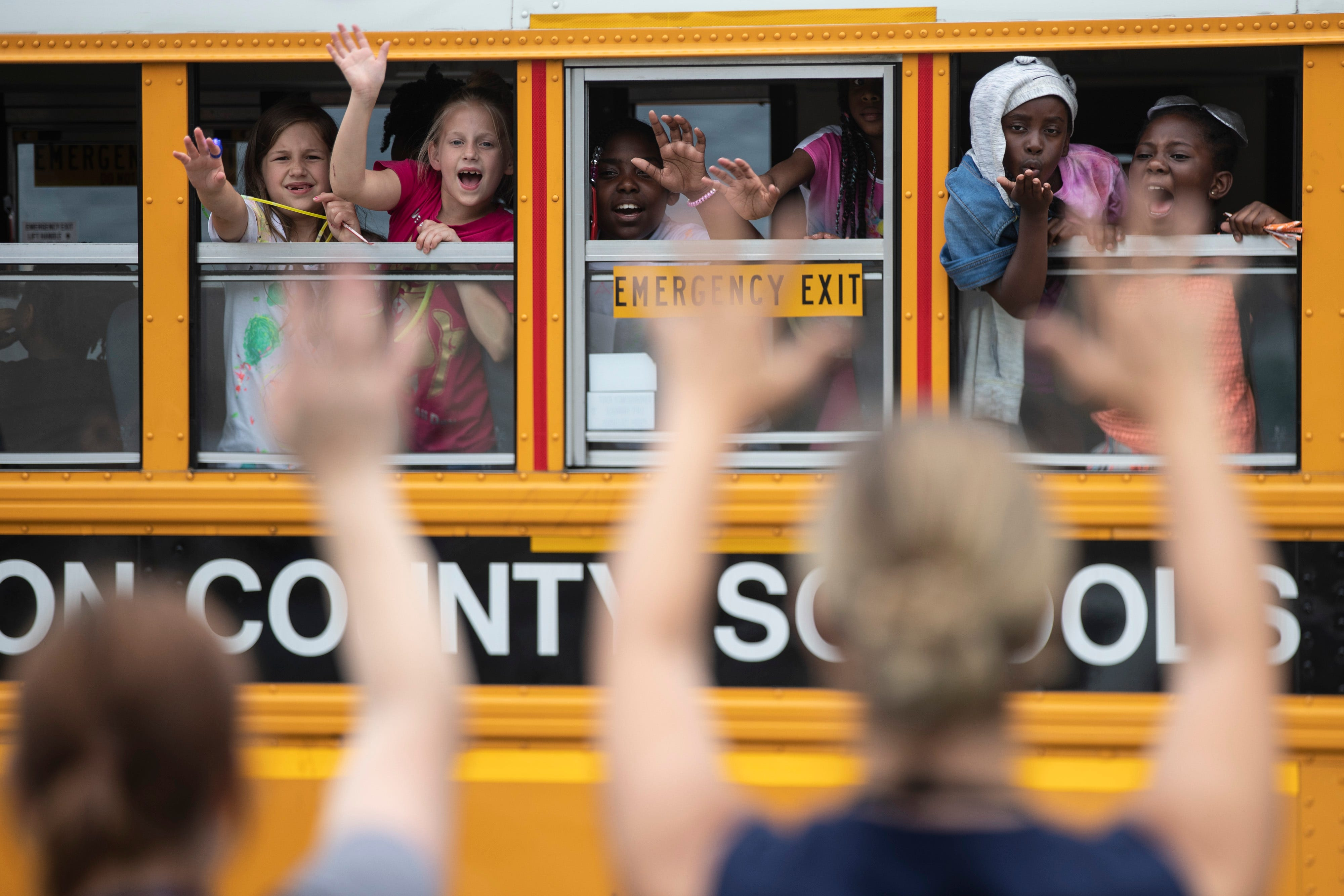 Lincoln Elementary students wave goodbye to teachers on the last day of school before summer break begins. June 7, 2019