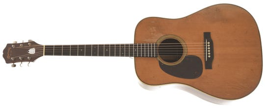 "The Martin D-28 guitar that belonged to bluegrass player ""Lefty"" Buchar that's for sale at Elderly Instruments."