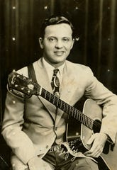 "Bluegrass player ""Lefty"" Buchar. Buchar's guitar was recently repaired at Elderly Instruments in Lansing."