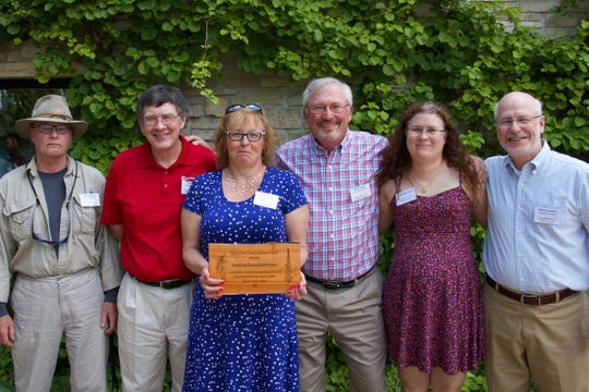 Volunteers at Woodland Dunes recently received an award for their work to eradicate invasive species. Pictured, from left:Anthony Munz, Ray Pollen, Kaye Katke, Mike Reese, Jennifer Klein andSteve Lankton.