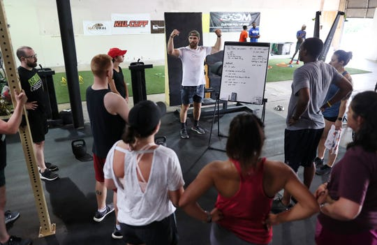 James Lancaster, owner of Deep River Fit in the Binghampton neighborhood, teaches a CrossFit class on Friday, June 7, 2019.