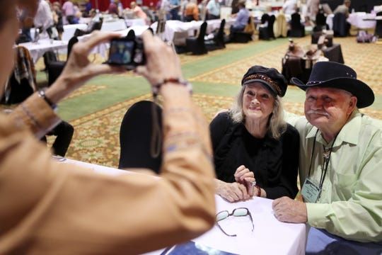 Former hollywood actress Angie Dickinson has a photo taken with fan Jerry Chouinard as she signs autographs during the Memphis Film Festival at Sam's Town Hotel & Gambling Hall in Tunica on Friday, June 7, 2019.