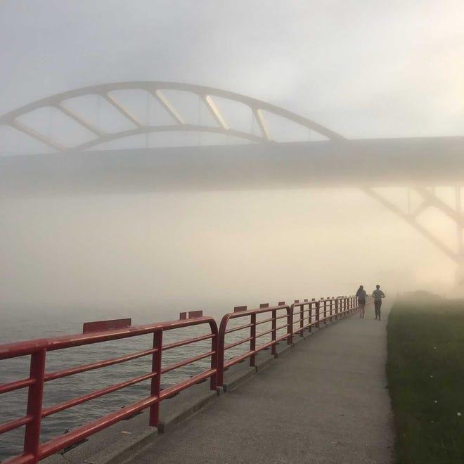 A heavy fog filled the air near the Milwaukee Pierhead Lighthouse, making the Hoan Bridge less visible Thursday.