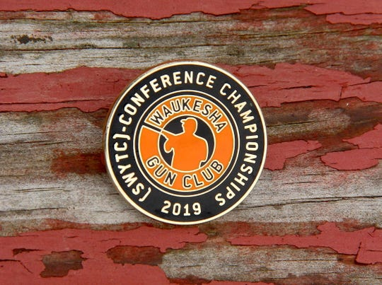 A pin was provided to participants commemorating the 2019 Southeast Wisconsin Youth Trapshooting Conference Championships held May 31 and June 1 at Waukesha Gun Club. A record 463 students participated in the event.
