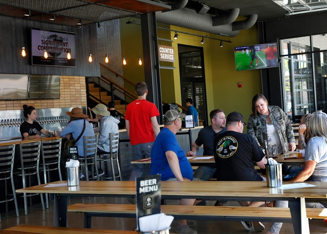 Patrons sit at Good City Brewing's taproom across from Fiserv Forum on Friday. Good City is among the 12 manufacturers on the Future 50 list of fastest-growing companies.