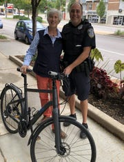 Riverwest resident Mary Jane Brummitt has her stolen bike returned by Officer Mike Driscoll.