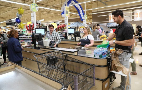 Brewers principal owner Mark Attanasio ran the checkout register, while Ryan Braun bagged groceries for the customers and they both paid for those groceries.