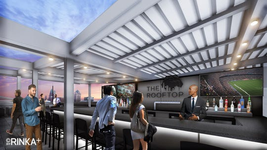The black stainless-steel, L-shaped bar was custom-made for The Rooftop patio, which was designed to have 360-degree views of the city. It's also designed to be open year-round.