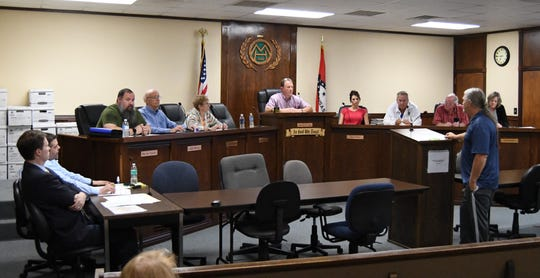 Mountain Home's Friday Night Block Party organizer Ron Shire (at podium) addresses the Mountain Home City Council on Tuesday night.
